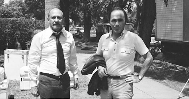 Donald Pleasence on set filming Halloween with executive producer Irwin Yablans. Note the trouser details seen here that aren't evident on screen. (Source: @TheLaurieStrode1978 Facebook account)