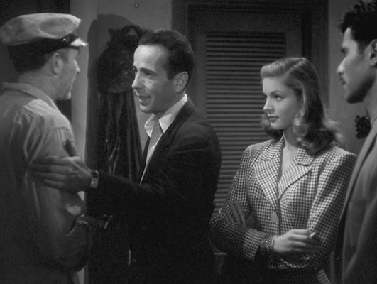Harry gives his pal Eddie (Walter Brennan, on loan from MGM) a reassuring pat on the arm, flashing a glimpse of his wristwatch.