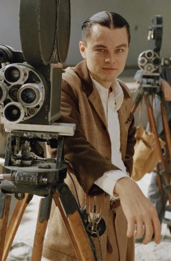 Promotional photo of Leonardo DiCaprio during production of The Aviator. Though dressed in Hughes' attire from these later 1947-set scenes, he is not mustached as he would be in the film to reflect Hughes' actual appearance at the time.