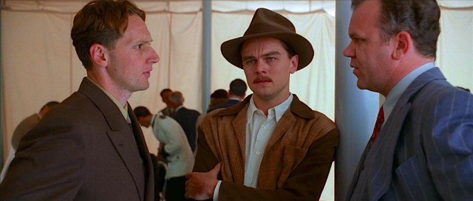 """""""Everybody works for you, Howard,"""" Hughes is assured by Noah Dietrich (John C. Reilly), here conferring with chief engineer Glenn Odekirk (Matt Ross) before the two quickly usher an increasingly panicking Hughes out of public view."""