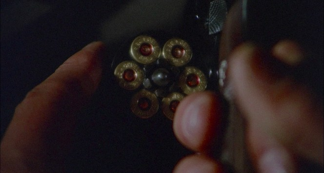 The significance of this shot increases when it is mirrored a few scenes later after the police superintendent checks to see if Costello's revolver was loaded.