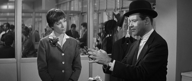 """The telltale compact... Fran is oblivious to the implications when Bud recognizes the cracked compact she handed him to admire his """"junior executive"""" bowler."""