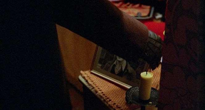Fuller's gloves keep him warm during the holiday season while also preventing him from compromising the crime scene with his own fingerprints.
