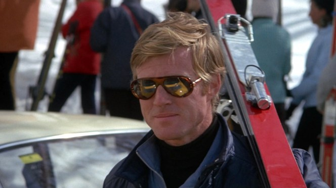 Carole's Porsche is reflected in Dave's mirrored lenses.