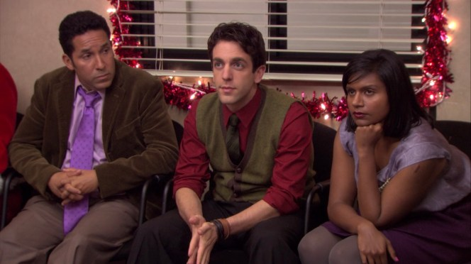 Ryan's red and green stands out as he sits flanked by Oscar and Kelly in their respective shades of purple.