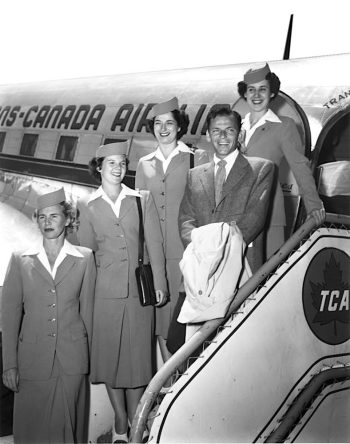 "Frank Sinatra, flanked by the stewardesses of his Trans-Canada Air Lines flight, circa 1950. The dawn of the ""jet age""—and the best years of Frank's career—were yet to come."