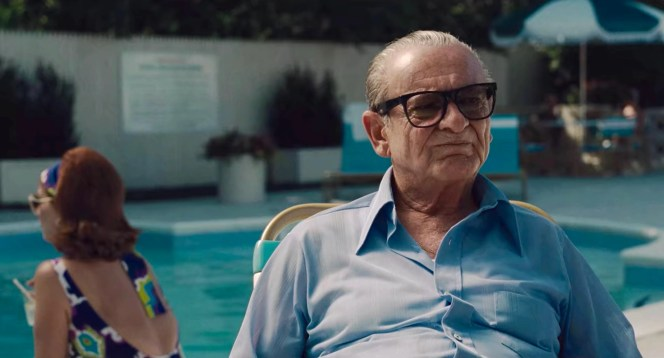 Russell has a chameleon-like ability to blend in with the atmosphere around him, sitting poolside in a blue shirt that reflects the water rather than traveling the dusty roads in his neutral tans and beiges.