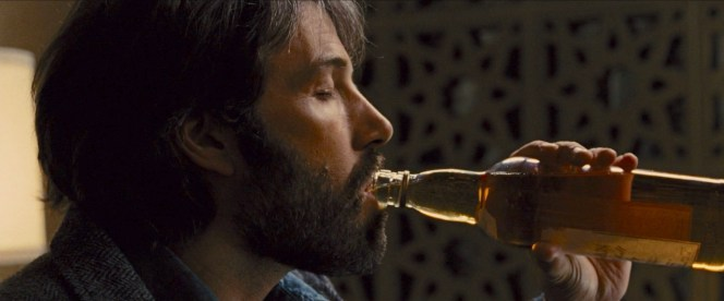 """The Macallan bottle in Argo appears to have a period-correct logo that doesn't reflect the whisky's age, instead following the word """"MACALLAN"""" with the scripted words """"Pure Highland Malt Scotch Whisky""""."""