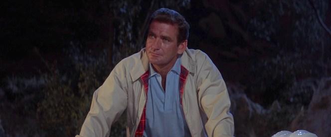 Bruce's unzipped Harrington jacket reveals the Fraser tartan plaid lining characteristic to true Baracuta jackets.