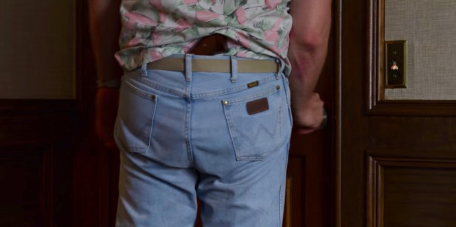 The butt of Hop's S&W Model 66 sticks out from the top of his Wrangler jeans, identified by their signature brand marks on the back pockets and seams.