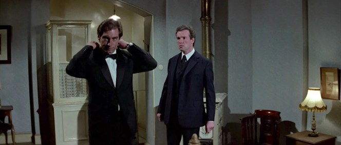 The Living Daylights provides a reversal of sorts of the iconic Goldfinger moment when Bond strips away his black tactical garb to reveal a white dinner jacket; Dalton's more serious Bond is the type who converts his fashionable evening wear into something more functional for the job.