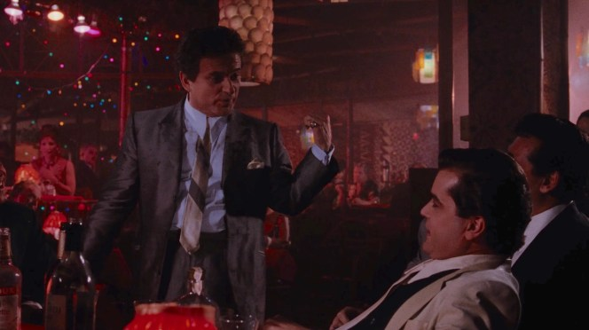 """You're supposed to be doin' this stuff, too,"" Tommy tells Henry... referring to harassing waiters and nightclub owners?"