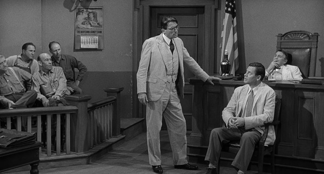 The judge sits back in his rumpled white linen and Atticus Finch elicits testimony from fellow seersucker-wearer Heck Tate.