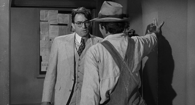 After Tom Robinson's indictment, Atticus gallantly suffers through the first of several increasingly aggressive encounters with the bigoted Bob E. Lee Ewell (James Anderson).