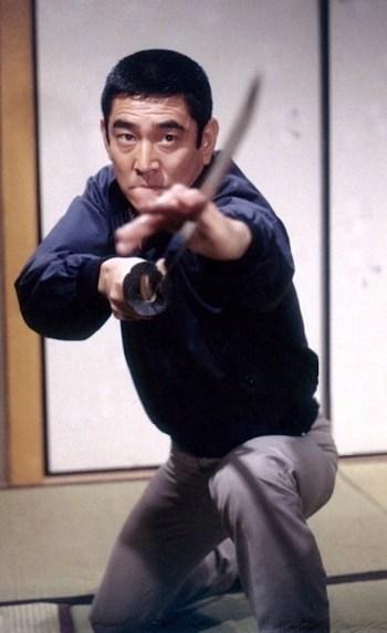 Ken Takakura as Ken Tanaka in The Yakuza (1974)