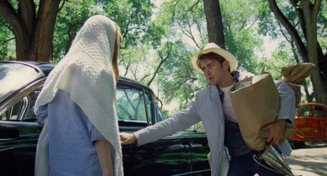 Evidently feeling gentlemanly in his [stolen] jacket and hat, Kit stops to open Holly's [stolen] car door for even with his hands full [of stolen goods].