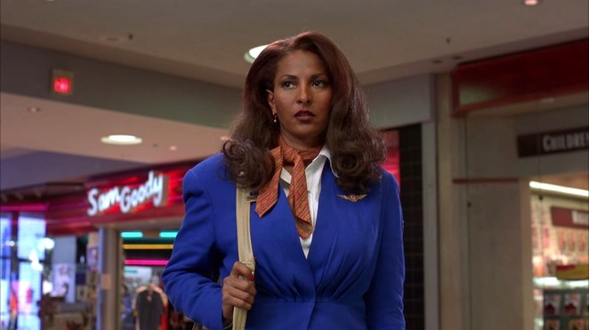 Jackie enters the mall in her Cabo Air uniform.
