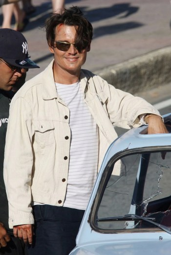 Johnny Depp in costume as Paul Kemp on the set of The Rum Diary (2009)
