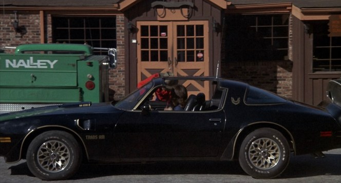"Frog picks up the Bandit in his own Trans Am outside the ""choke and puke"" where Sheriff Justice is wolfing down his diablo sandwich."
