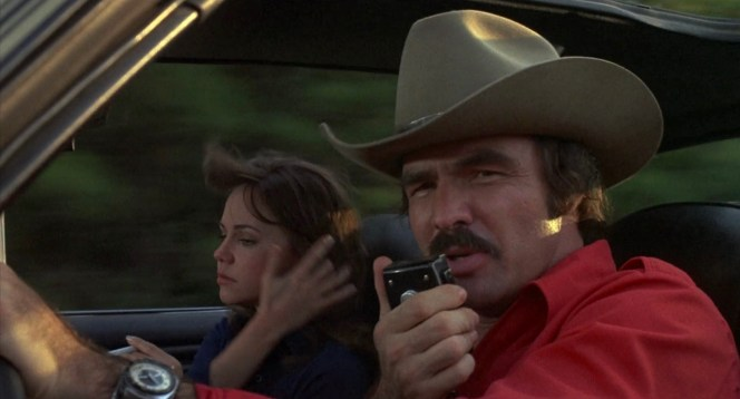 "The Bandit enlists the help of fellow truckers who've ""got them ears on"", soliciting a smokey report and finding solace in their ""rocking chair"" to evade the Alabama Highway Patrol."