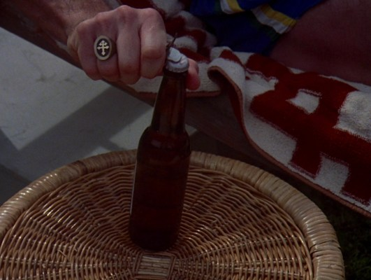 Magnum's Croix de Lorraine team ring gets significant screen-time in the pilot episode, such as when our hero cracks open a much-needed beer.
