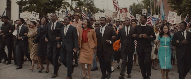 King leads the tens of thousands of marchers into Montgomery on the morning of Thursday, March 25, 1965.