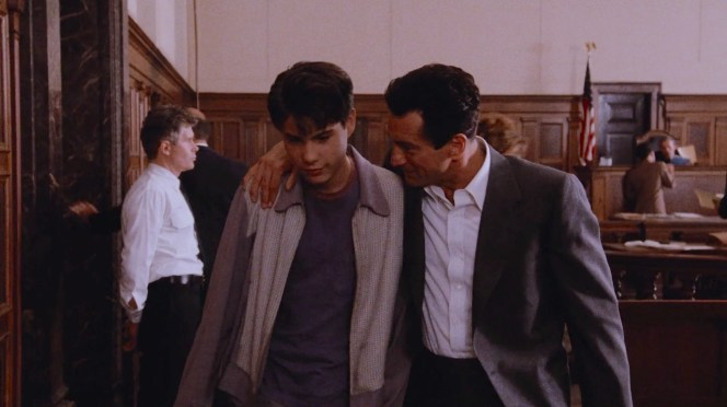 Proudly draping his arm around him to escort him from the courtroom, Jimmy's pride in the young Henry concretes his role as a de facto father figure, rewarding his new criminal vocation rather than beating him for it.