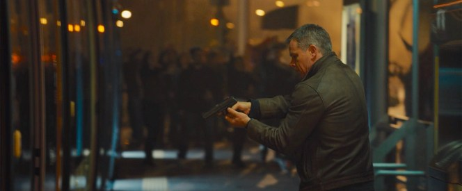 Bourne with his commandeered H&K USP pistol drawn in Athens.