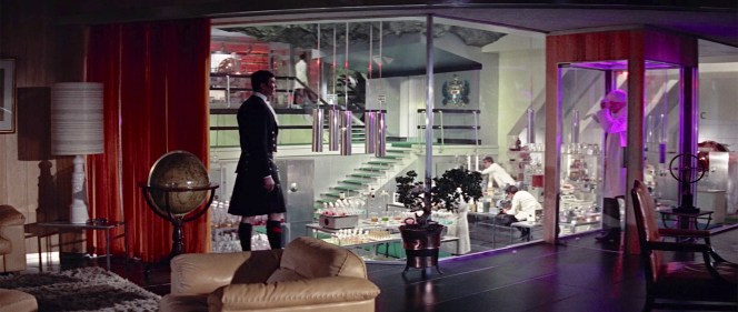 "Disguised in Highland dress as Sir Hilary Bray, Bond is soon no longer to be the only one clad in ancestral wear... though the glimpses he gets of Blofeld's trousers and boots under his lab coat fail to suggest the Bavarian outfit he would build once in ""Sir Hilary""'s presence."