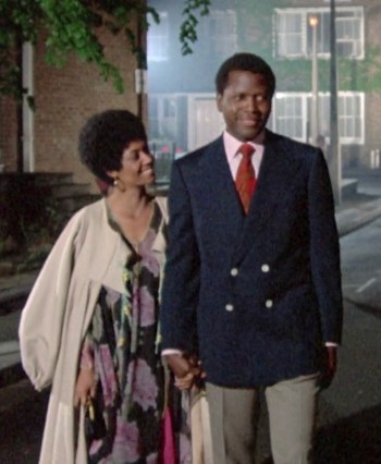 Sidney Poitier and Ester Anderson in A Warm December (1973)