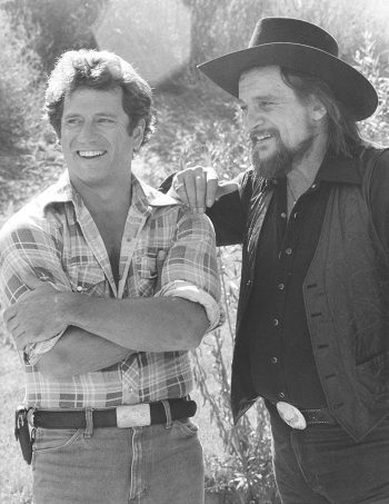 Tom Wopat and Waylon Jennings on the set of The Dukes of Hazzard