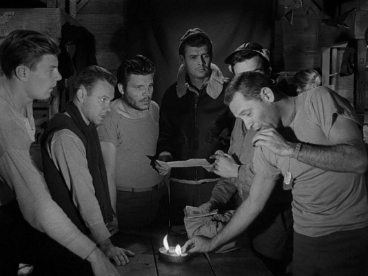 William Holden as Staff Sergeant J.J. Sefton in Stalag 17 (1953)