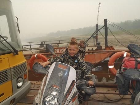Aldan river ferry next generation biker!
