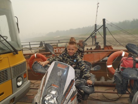 Aldan river ferry next generation biker!