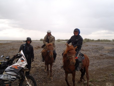 Mongolian river crossing horsemen.