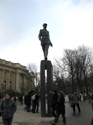 A statue of Charles de Gaulle, a French general during WWII after which one of the airports in Paris is named.