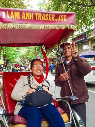 Annie and cyclo driver in Hanoi