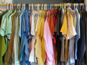 storing summer clothes, clothes hanging in a closet