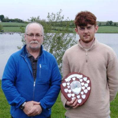 BAC - Sam Watt presents Patrick Curran with the Juvenile Angler of the Year Shield 2019 at the Corbet Lough on Thursday 27 May 2021