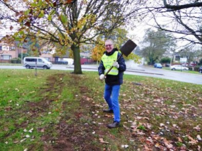Rtrn Malcolm Douglas brandishing spade