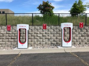 two white and red tesla charging station