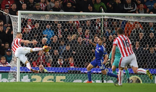 Stoke City's Austrian striker Marko Arnautovic (L) shoots to score the opening goal of the English Premier League football match between Stoke City and Chelsea at the Britannia Stadium in Stoke-on-Trent, central England on November 7, 2015. AFP PHOTO / PAUL ELLIS    RESTRICTED TO EDITORIAL USE. No use with unauthorized audio, video, data, fixture lists, club/league logos or 'live' services. Online in-match use limited to 75 images, no video emulation. No use in betting, games or single club/league/player publications..