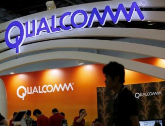 Qualcomm's logo is seen at its booth at the Global Mobile Internet Conference (GMIC) 2015 in Beijing, China, April 28, 2015. REUTERS/Kim Kyung-Hoon