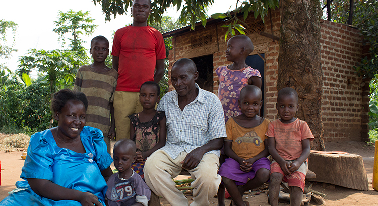 Gertrude and her husband with some of the 10 homeless children they look after.