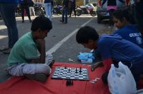 THE STREET BELONGS TO ALL: Kids make chess moves right across the streets of the neighborhood.