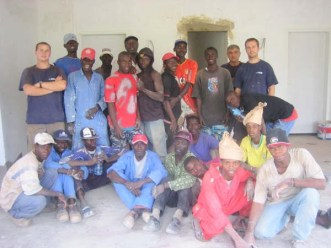 The MITIE building with their Gambian counterparts