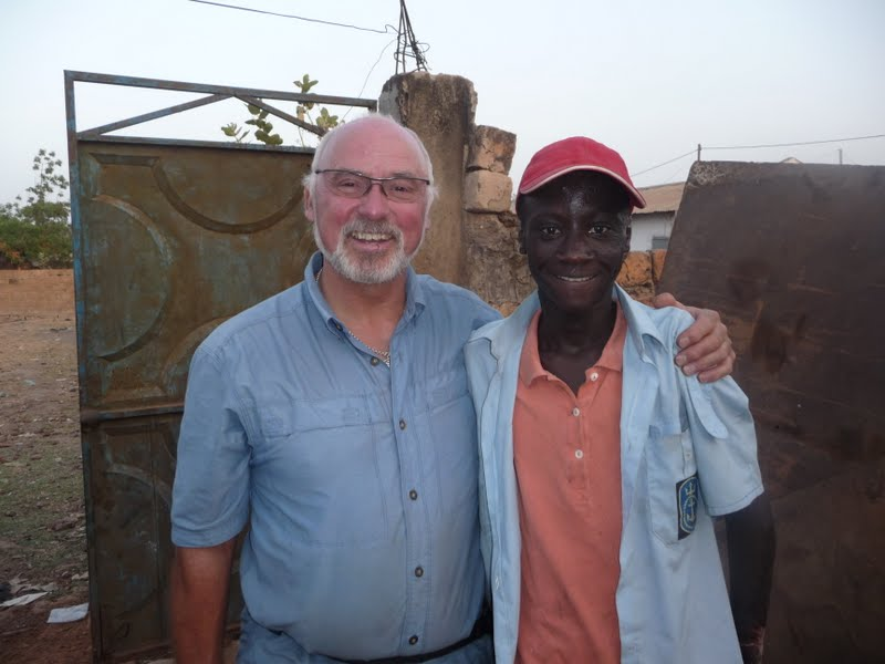 Mansaur at his compound, with his sponsor, Dennis Robinson