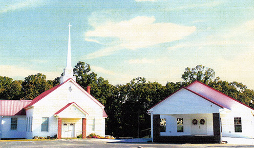 First Creek Baptist Church, left, and new fellowship building.