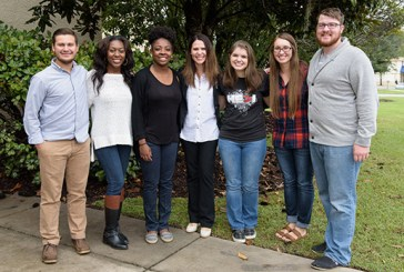 Izabella McMillon, center, is shown with CSU students after chapel. McMillon, now an employee of Operation Christmas Child, spoke about an OCC shoebox changing her life in Communist Romania 20 years ago. (Photo by Rick Esposito)