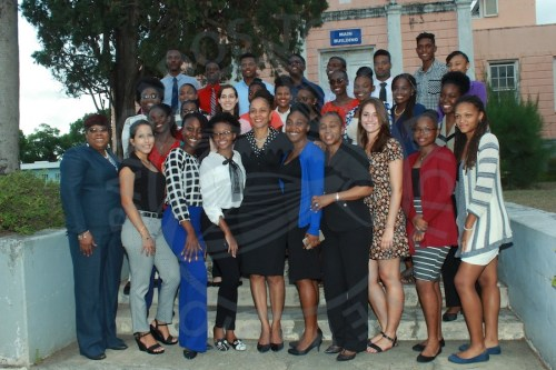 Exhibition winners pose with Minister of Education Santia Bradshaw (front row, fifth from left) and Ministry of Education officials.